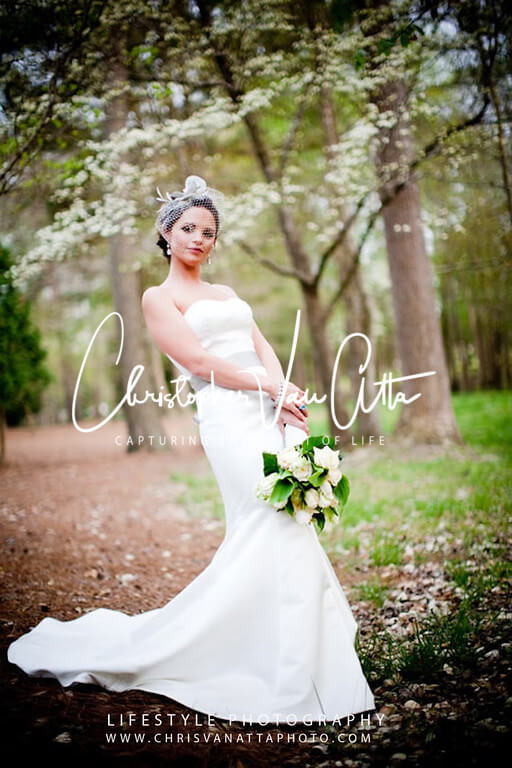 Couture bridal Portrait near a Dogwood tree